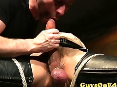 Edging BDSM dominant blows and tugs bound gay