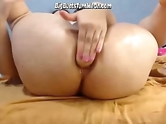 Busty Babe Shoving Dildo In Ass Hole
