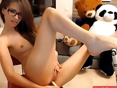 Horny brunette fucking herself on cam