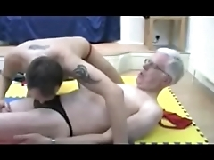 Two older men in thongs