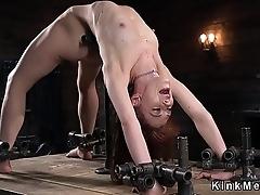 Skinny slave in metal bondage tormented