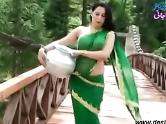 Roopi Shah Paki slut without blouse - nipple showing in wet saree- Desimasala.co
