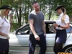 Uniformed british cops jerking sub outdoors