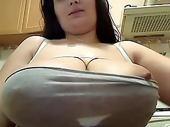 Hot woman teasing and showing huge tits for free webcam
