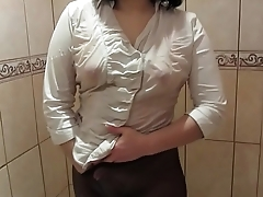 Girl in a white blouse, in black pantyhose masturbates in the shower to orgasm.
