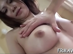 Japanese babe tames a huge dong