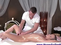 Pretty babe rides lucky masseurs hard cock