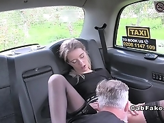 Slim hottie in stockings in fake taxi bangs