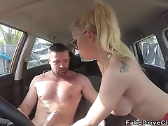 Beauteous deep throats in driving school in public