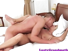 Chubby mature riding young dick