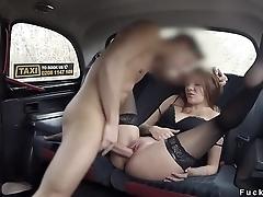 Lady in black stockings fucks in fake taxi