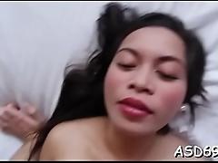 Thai cutie engulfs a huge cock