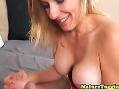 Busty stepmom jerking cock while in lingerie