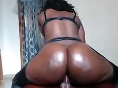 Super black girl rides ass on dildo live show